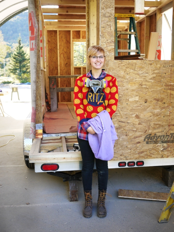 Me with the tiny house I helped to build, in my famous Ritz crackers sweater. Photo courtesy of Swan Moon.