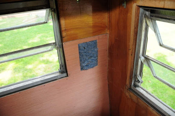 Here's a close-up of the little insulation view-hole. I have a picture frame that will go around that square when everything's finished.